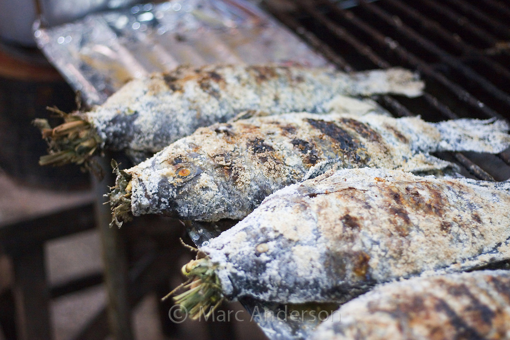 Grilled fish stuffed with lemongrass in a Thai food market, Nong Khai, Thailand