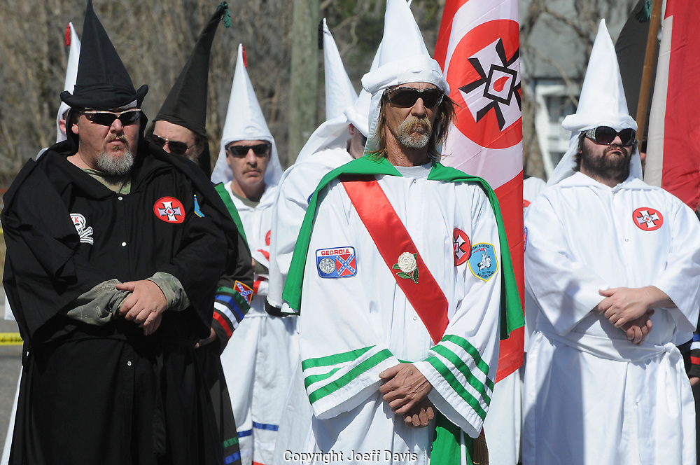 Close to 50 members of the Georgia Knight Riders and Knights of the Ku Klux Klan rallied for a crowd of more than 500 on Feb. 20 in the town of Nahunta, GA about 275 miles southeast of Atlanta. <br /> <br /> Klan members stood in ornate white robes and pointed hoods with faces exposed in front of a crowd of mostly enthusiastic onlookers for a two-hour rally. The few hecklers in the crowd were harshly scolded by supporters, while several dozen protesters, including the NAACP rallied nearby.<br /> <br /> Several Klan members spoke on topics ranging from gun control, sexual offenders, the value of prayer in public schools and the need to vote. <br /> <br /> However, most of the group's hateful speech was focused on eliminating &quot;the problems&quot; of illegal immigration and &quot;immigration in general.&quot; Standing next to a large sign that read, &quot;Stop the Latino Invasion Now!&quot; Imperial Wizard Jeff Jones referred to &quot;people coming over from Mexico and Guatemala&quot; as &quot;third-world mud people.&quot; Faulting the current administration's immigration policy, Wolf said &quot;they are going to commit genocide on this Anglo-American race.&quot; Jones also blamed illegal immigrants for the lack of jobs, low wages, drugs, gangs and the spread of diseases in the United States.<br /> <br /> &quot;We want them to take their sorry selves back to Mexico and stay out of our country,&quot; said Jones. &quot;We have got so many Latinos walking over the border everyday. They are taking over the whole work force because honestly very few, I don't think even one-tenth of one percent, has any job like a lawyer or a doctor.&quot;<br /> <br /> The rally ended with repeated chants of &quot;White Power&quot; as the Klan members raised their left arms in a brash Hitler salute.<br /> <br /> Watch a video of the event:<br /> http://tinyurl.com/yastu83