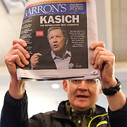 A supporter of Republican Presidential candidate John Kasich holds up copy of Baron's at a rally in Burlington, Wisconsin Saturday April 2, 2016. <br /> Photography by Jose More