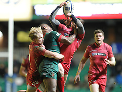 Leicester Tigers centre, Seremaia Bai challenges for the ball with Scarlets winger, Harry Robinson (right) and Scarlets scrum half Aled Davies (left) - Photo mandatory by-line: Dougie Allward/JMP - Mobile: 07966 386802 - 16/01/2015 - SPORT - Rugby - Leicester - Welford Road - Leicester Tigers v Scarlets - European Rugby Champions Cup