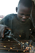 Cotonou September 2003 - Some types of work make useful, positive contributions to a child's development. Work can help children learn about responsibility and develop particular skills that will benefit them and the rest of society. Often, work is a vital source of income that helps to sustain children and their families. However, across the world, millions of children do extremely hazardous work in harmful conditions, putting their health, education, personal and social development, and even their lives at risk