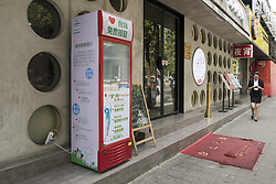 October 6, 2016 - Shanghai, Shanghai, China - Shanghai, CHINA-October 6 2016:?(EDITORIAL?USE?ONLY.?CHINA?OUT) A refrigerator providing free food can be seen near the entrance of a restaurant on Xikang Road, Shanghai, October 6th, 2016. The refrigerator is set up by a restaurant, aiming to share safe and extra food with people in need, which can also contribute to environmental protection. The restaurant puts about 25 boxes of redundant food into the charitable refrigerator every day on average. Besides, some kind-hearted customers will also put extra food into the fridge. Meanwhile, a non-governmental organization ¡®Green Food Bank¡¯ also provides food for the food-sharing fridge. (Credit Image: © SIPA Asia via ZUMA Wire)