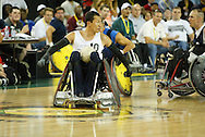 July 7th, 2006: Anchorage, AK - William Groulx looks back as he speeds down for another score as White defeated Blue in the gold medal game of Quad Rugby at the 26th National Veterans Wheelchair Games.