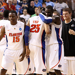 Mar 19, 2011; Tampa, FL, USA; Florida Gators players celebrate a win over the UCLA Bruins during second half of the third round of the 2011 NCAA men's basketball tournament at the St. Pete Times Forum. Florida defeated UCLA 73-65.  Mandatory Credit: Derick E. Hingle