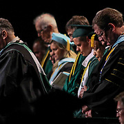 Wilmington University assistant professor, College of arts and sciences & coordinator of student affairs Gary L. Donahue. M. Ed., LEFT,  give the Benediction commencement exercise Sunday, May 17, 2015, at Chase Center On The Riverfront in Wilmington Delaware.