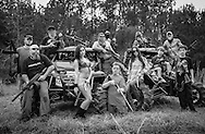 Proud Louisiana gun owners pose at a private shooting range.