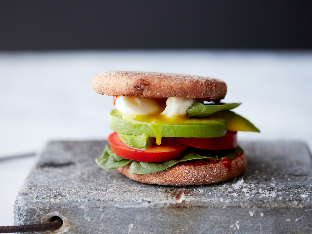 Poached Egg Sandwich on Whole Wheat Muffin with Spinach, Tomato and Avocado