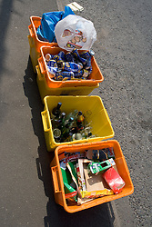 Household recycling bins waiting for collection,