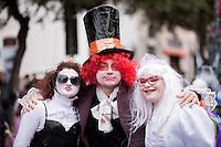 """Sfilata di carnevale a Gallipoli (LE) 2011. I film di successo dell'anno trascorso ispirano sempre qualche gruppo mascherato. In questo caso si tratta dell'ultima versione cinematografica di """"Alice nel paese delle meraviglie""""...Parade of Carnival at Gallipoli (LE) 2011. The successful films of the past year always inspire some masked group. In this case it is the last film version of """"Alice in Wonderland. """""""