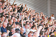 Leeds United fans celebrate Leeds United defender Ezgjan Alioski (10) scoring a goal to make the score 0-2 during the EFL Sky Bet Championship match between Stoke City and Leeds United at the Bet365 Stadium, Stoke-on-Trent, England on 24 August 2019.
