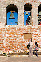 Mother and Daughter Looking at Old Mission Bells, San Juan Capistrano, California