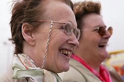 Two elderly women laughing,