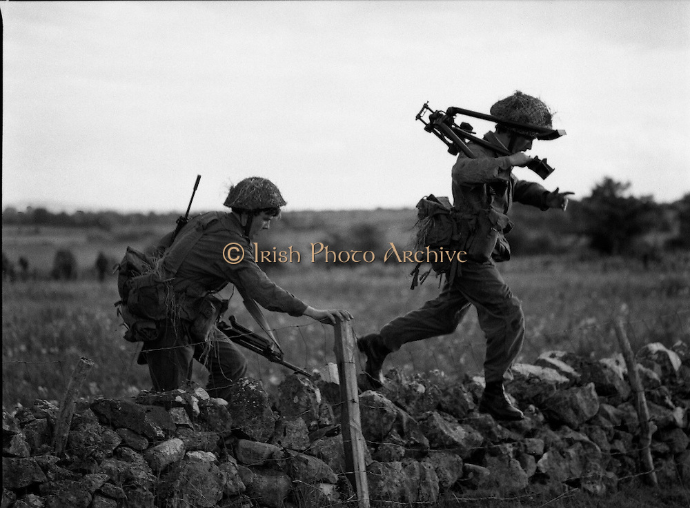 "Army Exercises In Co Sligo.   (L37).<br /> 1977.<br /> 05.09.1977.<br /> 09.05.1977.<br /> 5th September 1977.<br /> The Army Reserve Brigade, which is made up of regular units from the Southern Command, are conducting a series of conventional military exercises in counties Mayo and Sligo from the 5th to the 9th September. Approximately 1,500 men and 250 vehicles are involved. The exercise was codenamed ""Humbert"" after an ill fated expedition by French troops into Ireland on 23rd August 1798. 1,100 French troops with Irish support took on the incumbent English forces. After some initial success they were defeated at Ballinamuk on 8th Sept 1798 by the army of Cornwallis.<br /> <br /> Picture shows some soldiers advancing to take up position during the military exercises."
