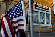Deana Taylor, acting postmistress of Bath, Illinois, raises the flag in front of the post office to start her Saturday morning duties in the Mason County, Illinois village. ©David Zalaznik