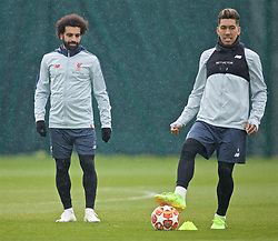 LIVERPOOL, ENGLAND - Tuesday, April 16, 2019: Liverpool's Mohamed Salah (L) and Roberto Firmino during a training session at Melwood Training Ground ahead of the UEFA Champions League Quarter-Final 2nd Leg match between FC Porto and Liverpool FC. (Pic by Laura Malkin/Propaganda)