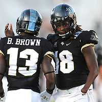 ORLANDO, FL - OCTOBER 14: Bryon Brown #13 of the UCF Knights and Shaquem Griffin #18 of the UCF Knights are seen during a NCAA football game between the East Carolina Pirates and the UCF Knights at Spectrum Stadium on October 14, 2017 in Orlando, Florida. (Photo by Alex Menendez/Getty Images)
