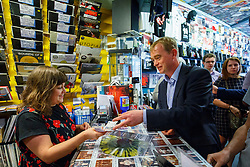 © Licensed to London News Pictures. 29/07/2015. Surrey, UK. Newly elected Liberal Democrat leader Tim Farron buys a Kraftwerk album whilst visiting Banquet Records in Kingston upon Thames and meeting two new Liberal Democrat councillors who have each won by-elections since the General Election on Wednesday, July 29, 2015. Photo credit: Tolga Akmen/LNP