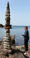 European Stone Stacking 2019 21 April 2019; The judges look at an entry into the European Stone Stacking 2019 at Eye Cave Beach, Dunbar.<br /> <br /> (c) Chris McCluskie | Edinburgh Elite media
