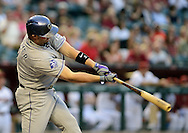 PHOENIX, AZ - APRIL 26:  Michael Cuddyer #3 of the Colorado Rockies connects for a two RBI base hit against the Arizona Diamondbacks in the first inning at Chase Field on April 26, 2013 in Phoenix, Arizona.