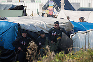 Calais, Pas-de-Calais, France - 25.10.2016    <br />  <br /> Beginn of the camp destruction on the 2nd day of the eviction on the so called &rdquo;Jungle&quot; refugee camp on the outskirts of the French city of Calais. Many thousands of migrants and refugees are waiting in some cases for years in the port city in the hope of being able to cross the English Channel to Britain. French authorities announced a week ago that they will evict the camp where currently up to up to 10,000 people live.<br /> <br /> Beginn des Camp Abrisses am zweiten Tag der Raeumung des so genannte &rdquo;Jungle&rdquo;-Fluechtlingscamp in der franz&ouml;sischen Hafenstadt Calais. Viele tausend Migranten und Fluechtlinge harren teilweise seit Jahren in der Hafenstadt aus in der Hoffnung den Aermelkanal nach Gro&szlig;britannien ueberqueren zu koennen. Die franzoesischen Behoerden kuendigten vor einigen Wochen an, dass sie das Camp, indem derzeit bis zu bis zu 10.000 Menschen leben raeumen werden. <br /> <br /> Photo: Bjoern Kietzmann