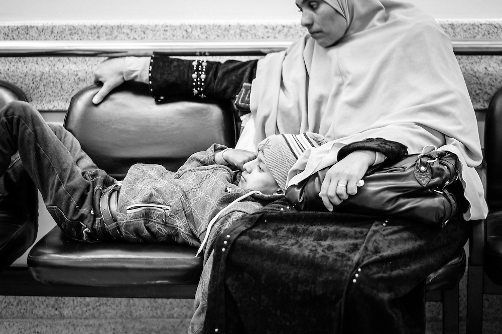 Abdallah, 11, waiting with his mother to be checked after his chemotherapy, Children's Cancer Hospital, Cairo, Egypt.