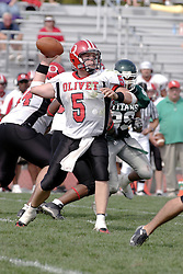 09 September 2006  Comet quarterback Calvin McNamara pumps to pass..In the first ever football competition between the Olivet Comets and the Illinois Wesleyan Titans, the Titans strut off the field with a 21- 6 victory. .Game action took place at Wilder Field on the campus of Illinois Wesleyan University in Bloomington Illinois.