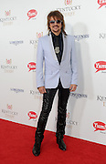 Bon Jovi guitarist Richie Sambora walks the Kentucky Derby Red Carpet, Saturday, May 3, 2014, in Louisville, Ky. Longines, the Swiss watchmaker known for its famous timepieces, is the Official Watch and Timekeeper of the 140th annual Kentucky Derby. (Photo by Diane Bondareff/Invision for Longines/AP Images)