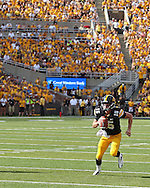 August 31 2013: Iowa Hawkeyes quarterback Jake Rudock (15) scrambles with the ball during the second quarter of the NCAA football game between the Northern Illinois Huskies and the Iowa Hawkeyes at Kinnick Stadium in Iowa City, Iowa on August 31, 2013. Northern Illinois defeated Iowa 30-27.