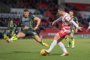 Doncaster Rovers Midfielder Tommy Rowe (10) crosses the ball during the EFL Sky Bet League 1 match between Doncaster Rovers and Bristol Rovers at the Keepmoat Stadium, Doncaster, England on 27 January 2018. Photo by Craig Zadoroznyj.