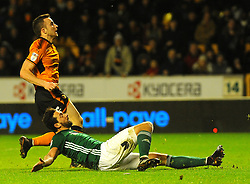 Diogo Jota of Wolverhampton Wanderers is tackled by Yoann Barbet of Brentford  - Mandatory by-line: Nizaam Jones/JMP - 02/01/2018 - FOOTBALL - Molineux - Wolverhampton, England- Wolverhampton Wanderers v Brentford -Sky Bet Championship