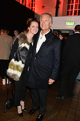 CHLOE DELEVINGNE and her father CHARLES DELEVINGNE at the YSL Beauty: YSL Loves Your Lips party held at The Boiler House,The Old Truman Brewery, Brick Lane,London on 20th January 2015.
