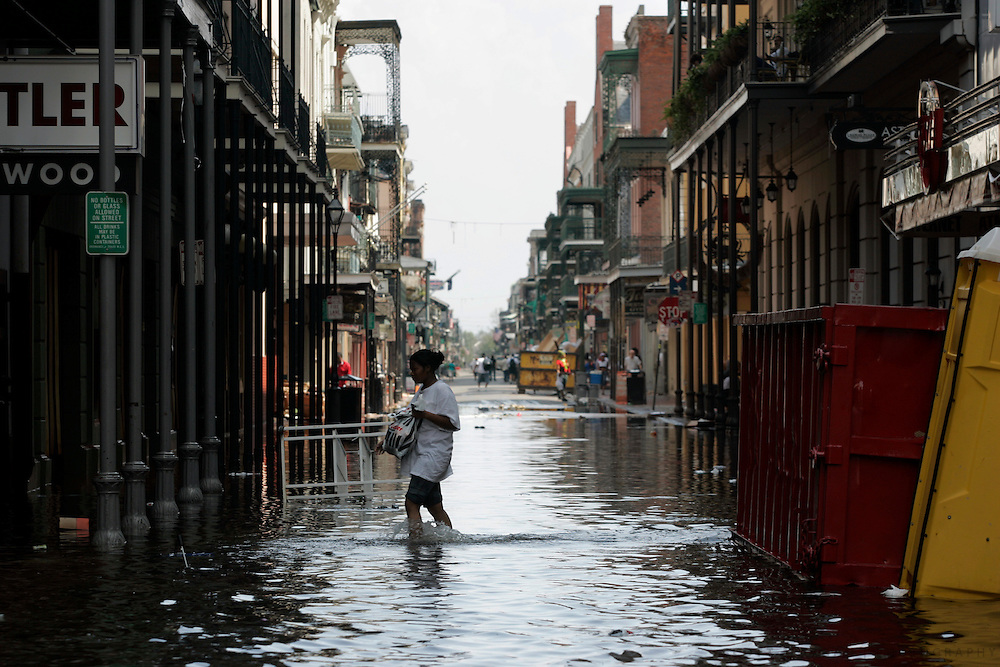 A woman crosses a flooded Bourbon Street Wednesday, August 31, 2005, in the french quarter of New Orleans, La. Scott Morgan