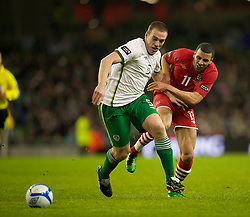 DUBLIN, IRELAND - Tuesday, February 8, 2011: Wales' Hal Robson-Kanu and the Republic of Ireland's Richard Dunne during the opening Carling Nations Cup match at the Aviva Stadium (Lansdowne Road). (Photo by David Rawcliffe/Propaganda)