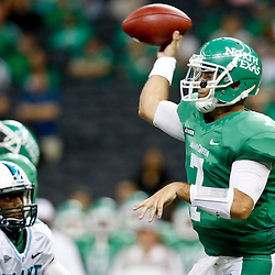 Oct 5, 2013; New Orleans, LA, USA; North Texas Mean Green quarterback Derek Thompson (7) throws after the game during the first half at Mercedes-Benz Superdome. Mandatory Credit: Derick E. Hingle-USA TODAY Sports