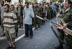 The militaries of the self-proclaimed Donetsk People's Republic escort Ukrainian army soldiers which now prisoners of war celebration of Ukraine's Independencein day in downtown of Donetsk, Ukraine, 24 August 2014.