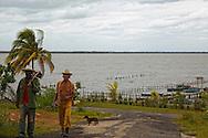 Men and dog in Playa La Mulata, Pinar del Rio, Cuba.