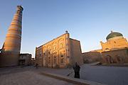 Uzbekistan, Khiva, Ichon-Qala.<br /> Islom-Hoja Minaret, Makhmud Pakhlavan Mausoleum (r.)
