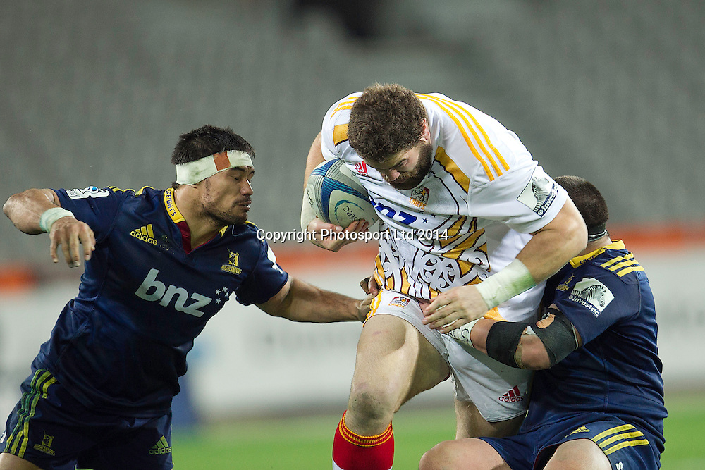 Jamie Mackintosh of the Highlanders is tackled during the Super Rugby game between The Chiefs and The Highlanders, Forsyth Barr Stadium, Dunedin. 27 June 2014. Photo: Teaukura Moetaua/www.photosport.co.nz
