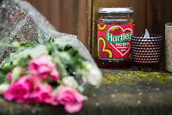© Licensed to London News Pictures. 28/03/2018. Liverpool, UK. A jar of Hartley's Strawberry Jam amongst the flowers and candles . Rows of flowers and tributes left outside Ken Dodd's lifetime home in Knotty Ash on the morning of the funeral of comedian and performer Sir Ken Dodd , who died on 11th March 2018 at the age of 90 . Photo credit: Joel Goodman/LNP