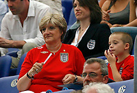 Photo: Glyn Thomas.<br />England v Portugal. Quarter Finals, FIFA World Cup 2006. 01/07/2006.<br /> David Beckham's son (R) Brooklyn Beckham and his mother (L).
