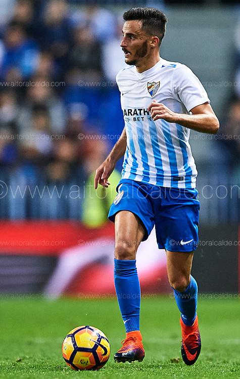 MALAGA, SPAIN - DECEMBER 09:  Juan Carlos Perez of Malaga CF in action during La Liga match between Malaga CF and Granada CF at La Rosaleda Stadium December 9, 2016 in Malaga, Spain.  (Photo by Aitor Alcalde Colomer/Getty Images)