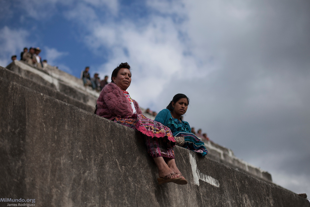 "Women sit on top of an ancient Mayan structure awaiting the start of a Western People's Council (Consejo de Pueblos del Occidente - CPO -, in Spanish) political event in the ancient Mayan site of Zaculeu on the last day of the Mayan Era known as 13 Baktun. The CPO, which held a political event to counteract the official State-run celebrations, claim ""it is offensive for the Maya people to see the economic power and government institutions promote the folklorization of Oxlajuj B'ak'tun, commodifying this important event, creating a political image out of tourist promotion and the presentation of spectacles, in a way that does not appropriately interpret the Maya cosmovision"" . Zaculeu, Huehuetenango, Guatemala. December 21, 2012."