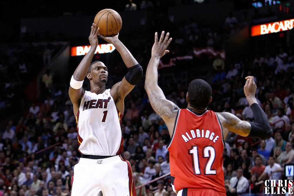 08 March 2011: Miami Heat power forward Chris Bosh (1) takes a jumpshot over Portland Trail Blazers power forward LaMarcus Aldridge (12) during the Portland Trail Blazers 105-96 victory over the Miami Heat at the AmericanAirlines Arena, Miami, Florida, USA.