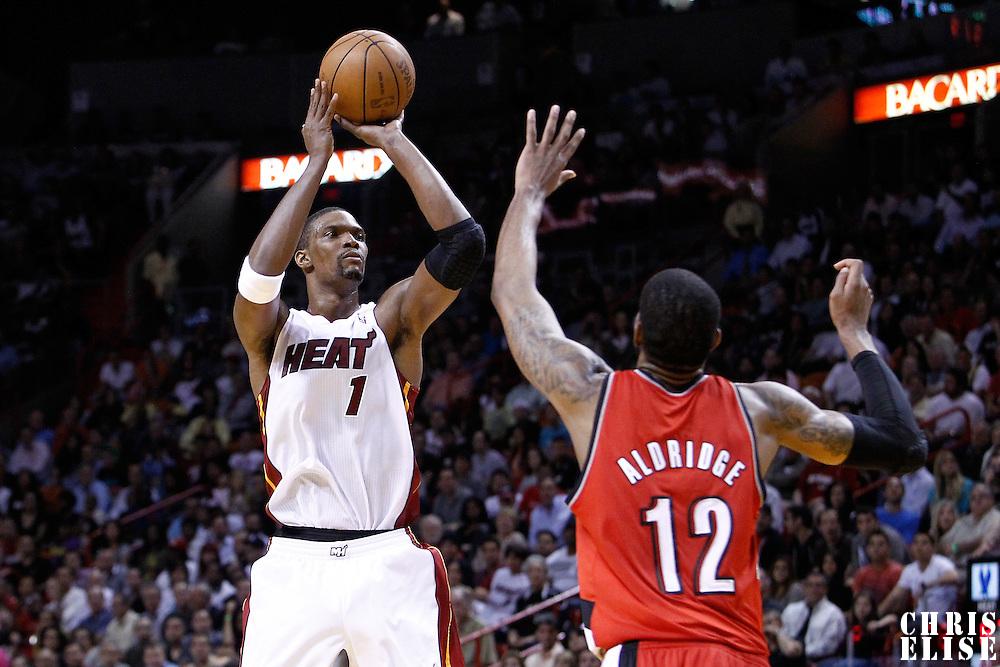 08 March 2011: Miami Heat power forward Chris Bosh (1) takes a jumpshot over Portland Trail Blazers power forward LaMarcus Aldridge (12) during the Portland Trail Blazers 105-96 victory over the Miami Heat at the AmericanAirlines Arena, Miami, Florida, USA.