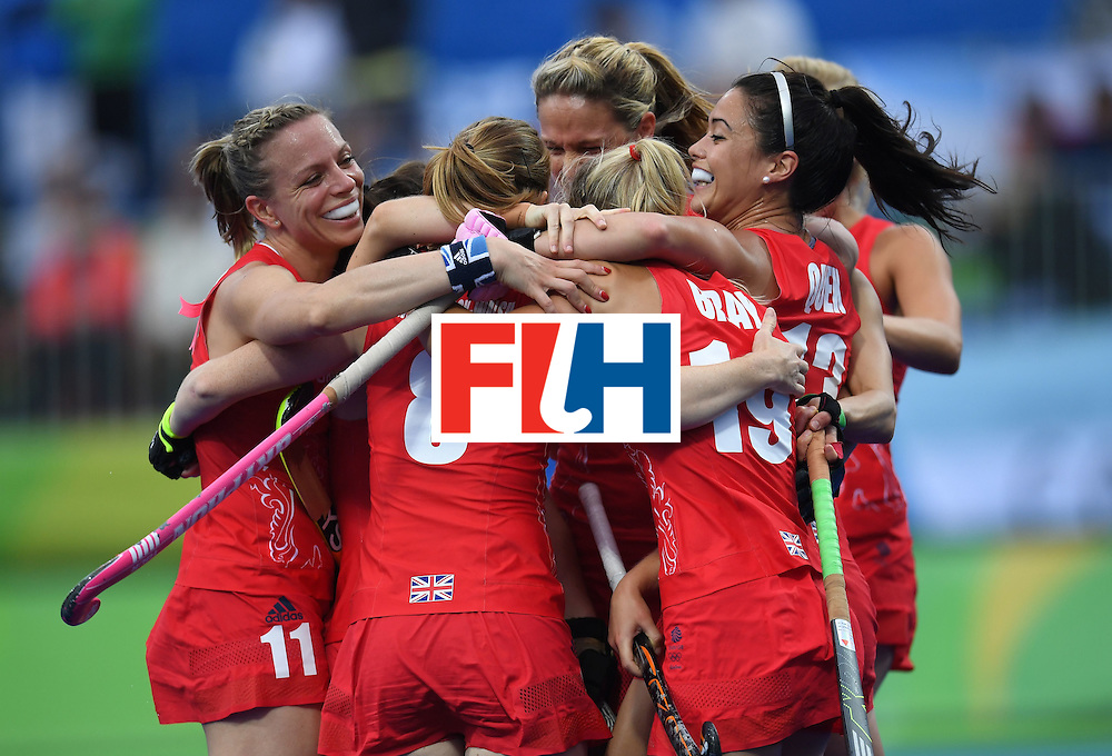 Britain's Kate Richardson-Walsh (L) celebrates scoring a goal with teammates during the women's field hockey Britain vs Argentina match of the Rio 2016 Olympics Games at the Olympic Hockey Centre in Rio de Janeiro on August, 10 2016. / AFP / MANAN VATSYAYANA        (Photo credit should read MANAN VATSYAYANA/AFP/Getty Images)