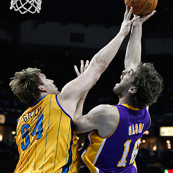 February 5, 2011; New Orleans, LA, USA; Los Angeles Lakers power forward Pau Gasol (16) shoots over New Orleans Hornets center Aaron Gray (34) during the third quarter at the New Orleans Arena. The Lakers defeated the Hornets 101-95.  Mandatory Credit: Derick E. Hingle