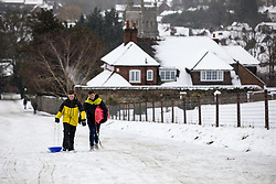 © Licensed to London News Pictures. 11/12/2017. Amersham, UK. Carl and Elliot from Amersham plays in the snow in Amersham. Yesterday parts of the south east of England experienced heavy snow, with the home counties experiencing some of the worst conditions. Many schools in the area are closed today. Photo credit : Tom Nicholson/LNP