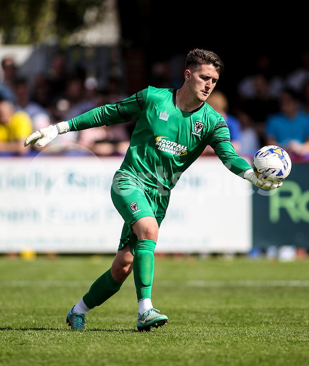 Joe McDonnell of AFC Wimbledon in action during the Pre-season Friendly match between AFC Wimbledon and Watford at the Cherry Red Records Stadium, Kingston, England on 11 July 2015. Photo by Ken Sparks.