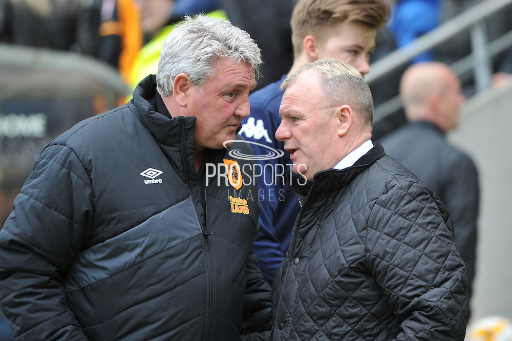 Hull City manager Steve Bruce and Steve Evans manager of Leeds United during the Sky Bet Championship match between Hull City and Leeds United at the KC Stadium, Kingston upon Hull, England on 23 April 2016. Photo by Ian Lyall.