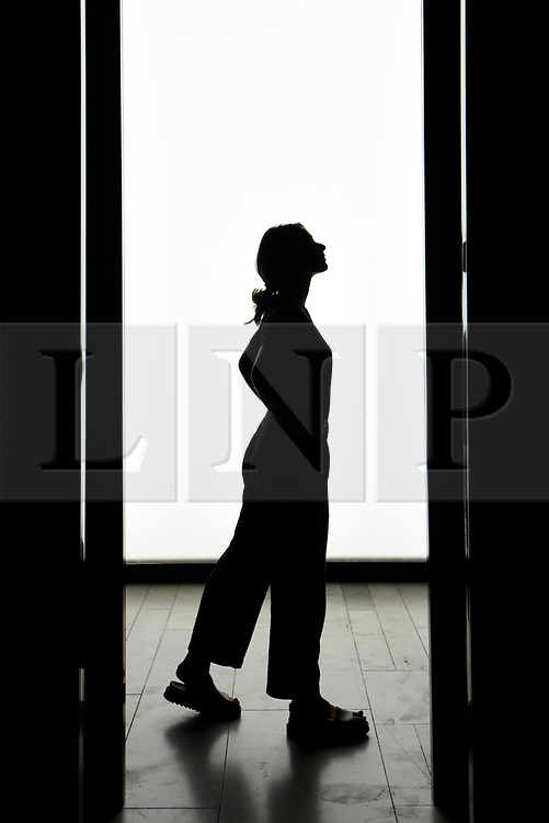 """© Licensed to London News Pictures. 13/09/2019. LONDON, UK. A staff member is silhouetted in """"Avalanche"""" by Matthew McCormick on display at the V&A museum as part of London Design Festival.  The festival, now in its 17th year, includes installations across the capital and runs 14 to 22 September 2019.  Photo credit: Stephen Chung/LNP"""